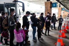 Migrants mostly from Central America are dropped off by the US Customs and Border Protection at a bus station near the Gateway International Bridge, between the cities of Brownsville, Texas, and Matamoros, Mexico, on March 15, 2021, in Brownsville, Texas. (Photo by CHANDAN KHANNA/AFP via Getty Images)