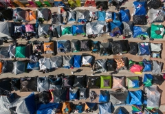 Aerial view of a migrants camp where asylum seekers wait for US authorities to allow them to start their migration process outside El Chaparral crossing port in Tijuana, Baja California state, Mexico on March 17, 2021. (Photo by GUILLERMO ARIAS/AFP via Getty Images)