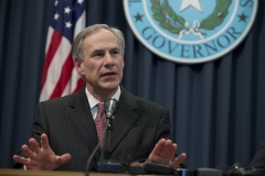 Gov. Greg Abbott speaks to the Texas press as Republicans celebrate a federal judge's decision to halt President Obama's executive action on immigration. (Photo credit: Robert Daemmrich Photography Inc/Corbis via Getty Images)