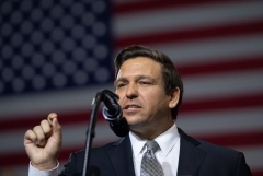 Ron DeSantis speaks during a rally with former President Donald Trump. (Photo credit: SAUL LOEB/AFP via Getty Images)