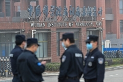 Chinese security personnel outside the Wuhan Institute of Virology in Wuhan,  China's specialist lab studying pathogens including bat and human coronaviruses. (Photo by Hector Retamal/AFP via Getty Images)