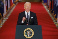 President Joe Biden marks the anniversary of the start of the Covid-19 pandemic on March 11, 2021. (Photo by MANDEL NGAN/AFP via Getty Images)