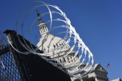 Razor wire is seen on fencing near the US Capitol Building on March 3, 2021. (Photo by ERIC BARADAT/AFP via Getty Images)