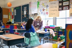 First Lady Jill Biden chats with a student during a tour of Benjamin Franklin Elementary School in Meriden, Connecticut on March 3, 2021. (Photo by MANDEL NGAN/POOL/AFP via Getty Images)