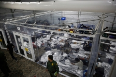 "Young illegal immigrants lie inside a ""pod"" at the Donna, Texas holding facility, the main detention center for unaccompanied children in the Rio Grande Valley run by the US Customs and Border Protection. Photo taken on March 30, 2021. (Photo by DARIO LOPEZ-MILLS/POOL/AFP via Getty Images)"
