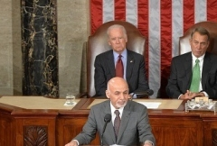 Then-Vice President Joe Biden looks on as Afghan President Ashraf Ghani addresses a joint session of Congress in March 2015. (Photo by Nicholas Kamm/AFP via Getty Images)