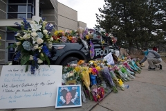 The police car belonging to Boulder Officer Eric Talley, one of ten people killed in a mass shooting at a King Sooper's grocery store, is covered in flowers on March 23, 2021. (Photo by JASON CONNOLLY/AFP via Getty Images)