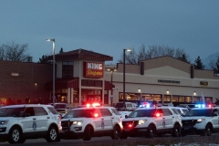 Police vehicles outside the King Soopers grocery store in Boulder, Colorado where a man opened fire on shoppers, killing ten, on March 22, 2021. (Photo by JASON CONNOLLY/AFP via Getty Images)