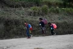 An indigenous woman and her children walk along a road in Guatemala. (Photo by JOHAN ORDONEZ/AFP via Getty Images)