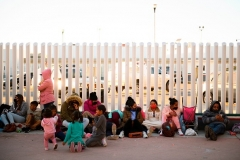 Asylum seekers wait outside the El Chaparral border crossing port in Tijuana, Mexico on February 19, 2021. (Photo by PATRICK T. FALLON/AFP via Getty Images)