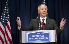 Asa Hutchinson announces the findings and recommendations of the National School Shield Program at the National Press Club. (Photo credit: JIM WATSON/AFP via Getty Images)