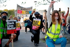 Protesters outside the U.S. Embassy in London, England last fall. (Photo by Tolga Akmen/AFP via Getty Images)