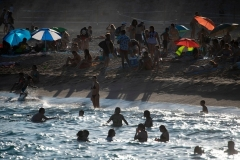 A Barcelona beach last summer. The upcoming one could see American visitors back in Europe.  (Photo by Josep Lago/AFP via Getty Images)