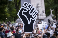 A protester holds a Black Lives Matter fist after George Floyd's death. (Photo credit: Ira L. Black/Corbis via Getty Images)