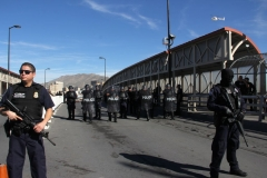 US customs and border patrol agents and riot policemen take part in a border security drill at the US-Mexico international bridge, as seen from Ciudad Juarez, Mexico, on October 29, 2018. (Photo by HERIKA MARTINEZ/AFP via Getty Images)