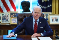 S President Joe Biden speaks before signing executive orders on health care, in the Oval Office of the White House in Washington, DC, on January 28, 2021. - The orders include reopening enrollment in the federal Affordable Care Act. (Photo by MANDEL NGAN/AFP via Getty Images)