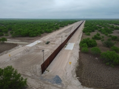 A photo taken on March 30, 2021 shows a general view of an unfinished section of a border wall that former US president Donald Trump tried to build near the southern Texas border city of Roma. (Photo by ED JONES/AFP via Getty Images)