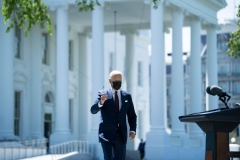 President Joe Biden removes his sunglasses while walking to speak about updated CDC guidance on masks for people who are fully vaccinated during an event in front of the White House April 27, 2021, in Washington, DC. (Photo by BRENDAN SMIALOWSKI/AFP via Getty Images)
