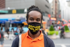 "A man wearing a ""defund police"" mask poses in Union Square as the city continues Phase 4 of re-opening following restrictions imposed to slow the spread of coronavirus on September 24, 2020 in New York City. (Photo by Alexi Rosenfeld/Getty Images)"