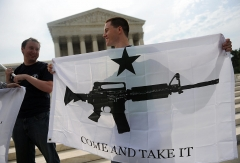 Gun rights activists celebrate the news from US Supreme Court June 26, 2008 that Americans have a constitutional right to bear arms, ending a ban on owning handguns in Washington, DC in its first ruling on gun rights in 70 years.  (Photo by TIM SLOAN/AFP via Getty Images)