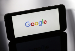 The Google logo is displayed on the screen of an iPhone. (Photo credit: Chesnot/Getty Images)
