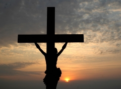 Featured is the silhouette of a depiction of Jesus on the cross. (Photo credit: NOAH SEELAM/AFP via Getty Images)