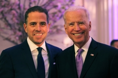 Hunter Biden takes a photo with father Joe Biden. (Photo credit: Teresa Kroeger/Getty Images)