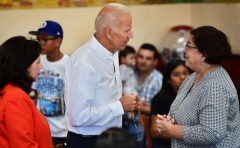 Joe Biden is given a rosary while meeting with individuals during the presidential campaign. (Photo credit: FREDERIC J. BROWN/AFP via Getty Images)