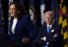 President Joe Biden and Vice President Kamala Harris give an address. (Photo credit: OLIVIER DOULIERY/AFP via Getty Images)