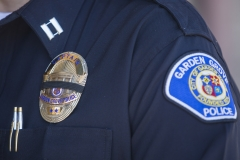 A police badge is featured. (Photo credit: APU GOMES/AFP via Getty Images)