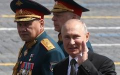Russian President Vladimir Putin and Defence Minister Sergei Shoigu. (Photo by Mikhail Svetlov/Getty Images)