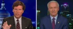 Tucker Carlson speaks with Arkansas Gov. Asa Hutchinson. (Photo credit: Fox News)