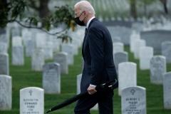 US President Joe Biden walks through Arlington National cemetary to honor fallen veterans of Afghan conflict in Arlington, Virginia on April 14, 2021. (Getty Images)
