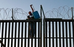 A foreigner attempts to illegally cross into the U.S. from Mexico on April 21, 2021 in San Luis, Arizona. (Photo by Nick Ut/Getty Images)