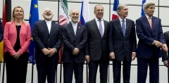 Then-Secretary of State John Kerry in Vienna in July 2015 with Iran nuclear deal partners, including Iranian foreign minister Javad Zarif, laughing. (Photo by Joe Klamar/AFP/Getty Images)