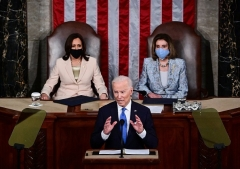 President Biden speaks to masked members of Congress in a sparsely populated room on April 28. ((Photo by JIM WATSON/POOL/AFP via Getty Images)