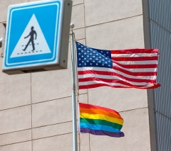 The gay pride flag is raised alongside the American flag  at the US embassy in Tel Aviv on June 13, 2014. (Photo by JACK GUEZ/AFP via Getty Images)