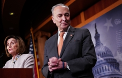 House Speaker Nancy Pelosi (D-CA) and Senate Majority Leader Chuck Schumer (D-NY) give an address. (Photo credit: MANDEL NGAN/AFP via Getty Images)
