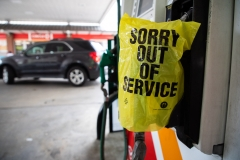 """An """"Out Of Service"""" bag covers a gas pump as cars continue lining up for the chance to fill their gas tanks at a Circle K near uptown Charlotte, NC on May 11, 2021 following a ransomware attack that shut down the Colonial Pipeline. (Photo credit: LOGAN CYRUS/AFP via Getty Images)"""