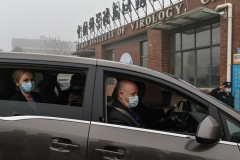 Peter Daszak (R), Thea Fischer (L) and other members of the World Health Organization (WHO) team investigating the origins of the COVID-19 coronavirus, arrive at the Wuhan Institute of Virology in Wuhan in China's central Hubei province on February 3, 2021. (Photo by HECTOR RETAMAL/AFP via Getty Images)