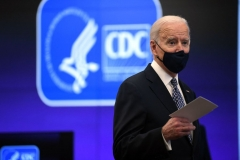 President Joe Biden speaks as he tours the Centers for Disease Control and Prevention in Atlanta, Georgia, on March 19, 2021. (Photo by ERIC BARADAT/AFP via Getty Images)