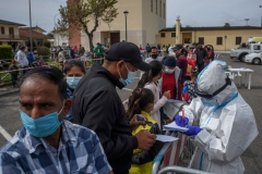 Members of the Indian community wait in line to receive a Covid-19 swab test in the Borgo Hermada neighbourhood, which is home to around 2500 Indian people, on May 3, 2021 in Terracina, Italy. (Photo by Antonio Masiello/Getty Images)