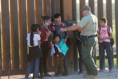 United States Border Patrol agents detain families from Central and South America who have been crossing into the United States from Mexico to ask for asylum, April 30, 2021 outside of Yuma, Arizona. (Photo by Andrew Lichtenstein/Corbis via Getty Images)