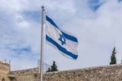 The Israeli flag waves on the western wall of Jerusalem. (Photo credit: Michael Jacobs/Art in All of Us/Corbis via Getty Images)