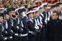 French President Emmanuel Macron reviews troops in Paris. (Photo by Ludovic Marin/Pool/AFP via Getty Images)