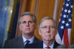 Former Senate Majority Leader Mitch McConnell (R), R-KY, stands next to former House Majority Leader Kevin McCarthy, R-CA, during a signing ceremony for the Keystone XL Pipeline Approval Act on Feb. 13, 2015. (Photo credit: MANDEL NGAN/AFP via Getty Images)