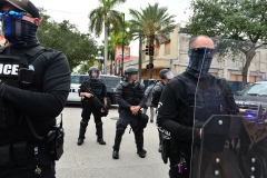 Police officers stand in riot gear. (Photo credit: Johnny Louis/Getty Images)
