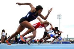 Track and field athletes compete in a race. (Photo credit: Tim Clayton/Corbis via Getty Images)