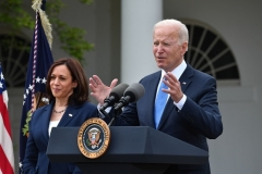 President Joe Biden and Vice President Kamala Harris appear without face masks to announced that fully vaccinated people don't need to wear them anymore. (Photo by NICHOLAS KAMM/AFP via Getty Images)
