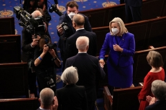 Rep. Liz Cheney (R-Wyo.) greets President Joe Biden with a fist bump before Biden addressed a joint session of Congress on April 28, 2021. (Photo by CHIP SOMODEVILLA/POOL/AFP via Getty Images)